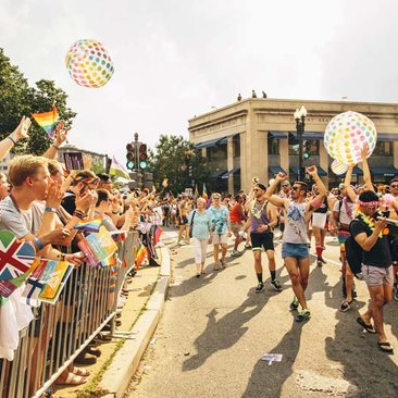 People celebrating during the Capital Pride Parade near Dupont Circle - Capital Pride events you don't want to miss this summer in Washington, DC