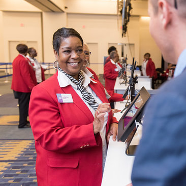 Destination DC Staffing Services redcoat assisting meeting or convention attendee at the Walter E. Washington Convention Center
