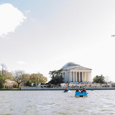 Boaters on Tidal Basin paddle boats during the National Cherry Blossom Festival - The best things to do this spring in Washington, DC