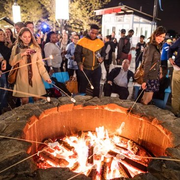 Visitors warming by the fire at The Wharf on the Southwest Waterfront - Free winter activities in Washington, DC