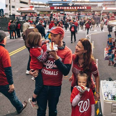 Family eating hot dogs before Washington Nationals baseball game in DC's Capitol Riverfront neighborhood