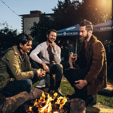 Friends around the fire at Wundergarten beer garden in NoMa - The best beer gardens in Washington, DC
