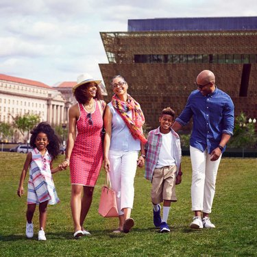 Family in front of Smithsonian NMAAHC