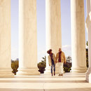 Couple walking along Jefferson Memorial - The most romantic places in Washington, DC