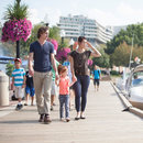 Family walking along the Georgetown Waterfront - Family-friendly activities in Washington, DC