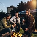 Friends around fire at Wunder Garten in NoMa - The best beer gardens in and around Washington, DC