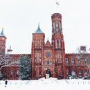 @kerryawheeler - Snow winter scene at the Smithsonian Castle on the National Mall in Washington, DC