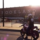 Guy on motorcycle in front of Brookland Metro