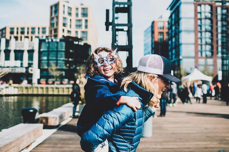 @thebanksapts - Parent with child on a pier at The Wharf - Things to do at The Wharf in Washington, DC