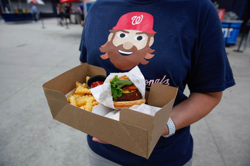 Washington Nationals fan with concessions at Nationals Park - The best places to eat at Nats Park in DC