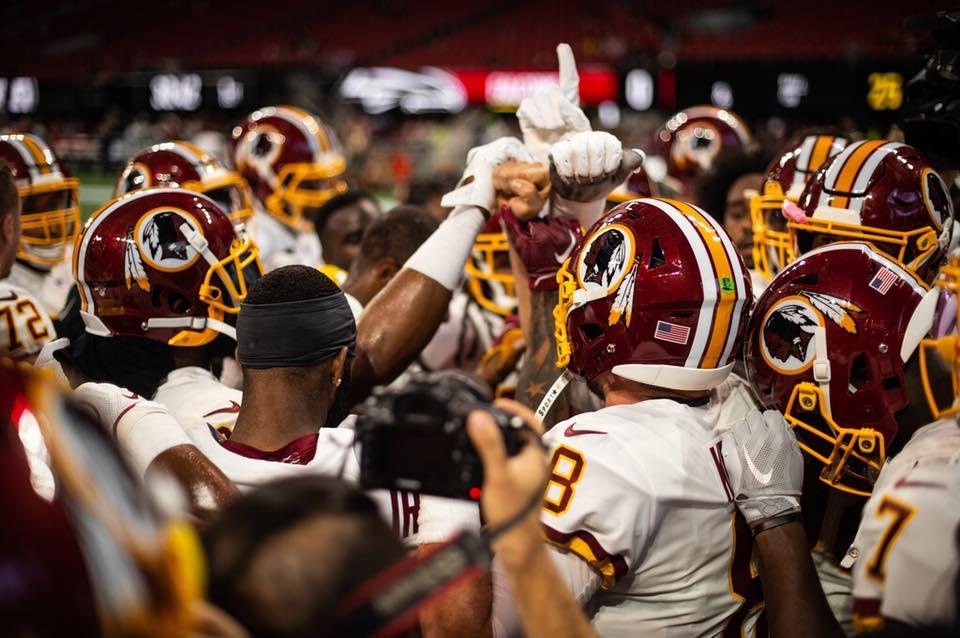 Washington Redskins team huddle - NFL football in Washington, DC