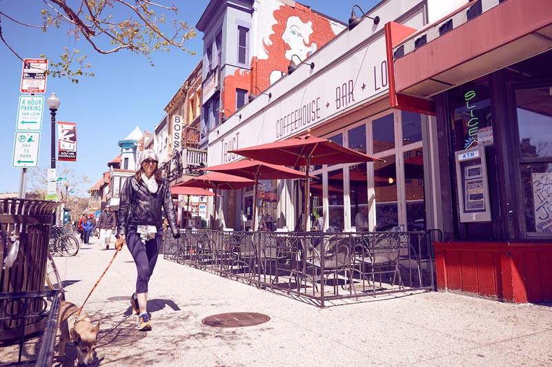 Woman walking down 18th Street in Adams Morgan by Tryst coffee shop - Things to do in DC's Adams Morgan neighborhood